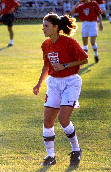 mia hamm young woman in shorts on soccer field