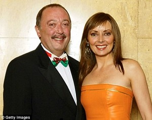 Anton & Carol Vorderman middle aged—standing nxt to ea other