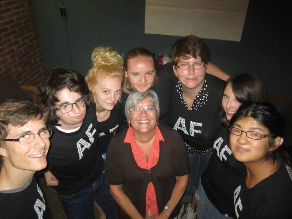 Pretty gal amid several AboutFace enthusiasts—all wearing AF t-shirts..