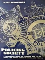 """Blue and white bookcover of """"Policing Society"""" wh deals with bullying ."""