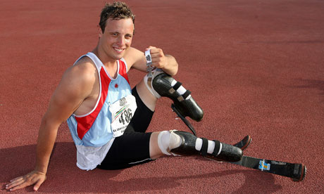 Sprinter Pistorius seated with prosthetic blades.