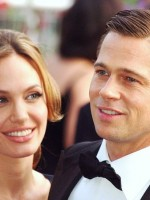 Angelina Jolie gazes at Brad Pitt