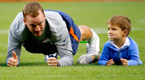 Peyton Manning's 4-year-old son led stretches for the Broncos before their preseason game