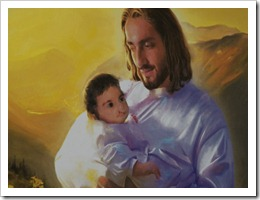 Painting of Jesus holding boy with cleft lip.
